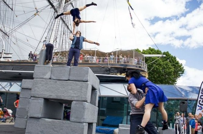 Photo of acrobatic performance in front of a boat