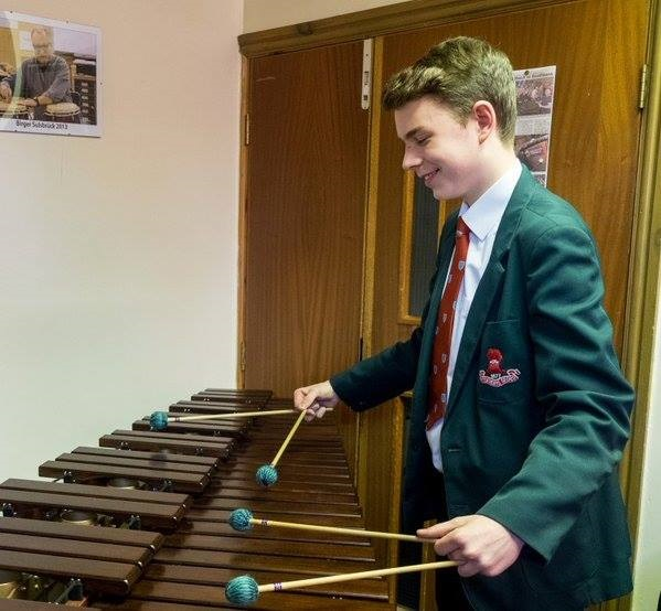 Photo of  boiy paying marimba