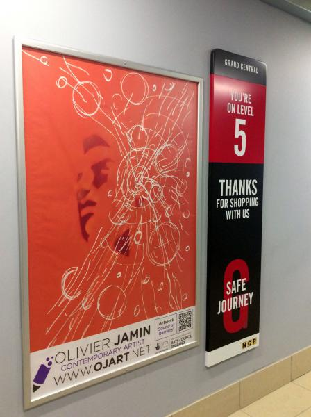 Photo of a poster featuring one of Olivier's artworks