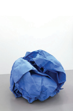 a blue piece of paper screwed up into a ball with a white background