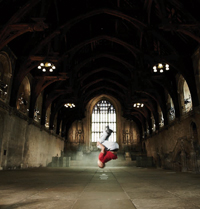 Photo of a street dancer in Westminster Hall as part of the somewhereto_ project in 'dream space'