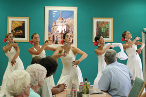 Spanish dancers, dancing infront of people sitting at a table