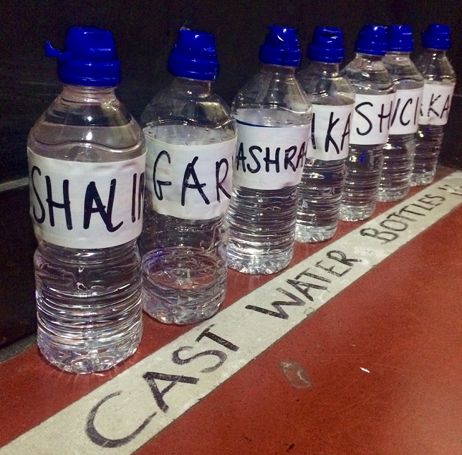 During Tech the cast generally work from 1pm - 10.00pm, but the creative team and crew are in from 9 or 10am. One of the many great things about working at TRSE is that we're all so well looked after. On each side of the stage in the wings is an area for cast water bottles. The theatre will refill them every day - it may seem like a small act but during these long days you can easily forget to hydrate, so for us this is a real gift. The theatre also provides hot food for everyone during dinner breaks!