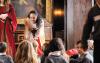 performer speaks to children