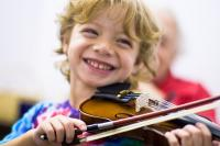 Photo of young boy playing the violin
