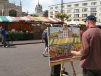 Photo of man painting in Cambridge's Market Square