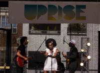 Photo of Miss Baby Sol and band at the Uprise Festival