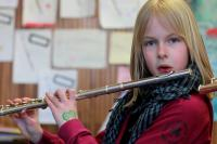 Photo of a girl playing the flute