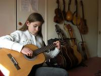 Photo of child playing guitar