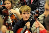 Photo of a boy in an orchestra