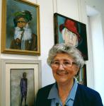 Photo of Anita Amy Harrison with her painting