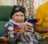 Photo of old woman holding a gun