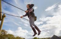 Photo of girl on swing