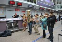 Brass instruments play at check-in.