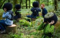 Photo of people wearing headsets in woodland
