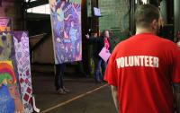 Photo of a man wearing a 'Volunteer' tshirt