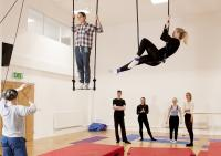 Photo of two aerial dancers, teacher and students