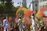 Photo of people throwing coloured powder