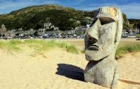 Photo of head sculpture on the beach