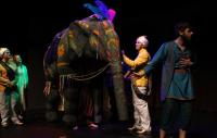 Actors and elephant puppet on stage