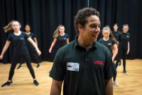 Photo of man and young people in dance studio