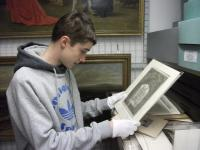 Photo of volunteer in collections section