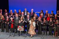 A choir of men and women on stage