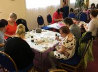 Photo of people doing craft activities