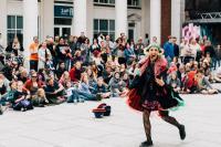 A woman performing in an outdoor square