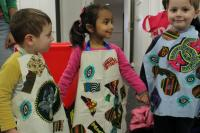 Photo of children in aprons