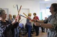 Photo of dancers with sticks