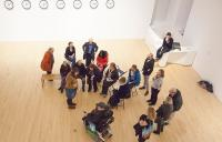 A photo of visitors in an art gallery, including a wheelchair user
