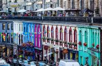 A photograph of colourful houses on a street in Edinburgh