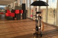 Photo of tower of lamps, steel & umbrella