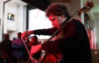A photo of a man playing a cello