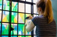 Artist working on coloured window
