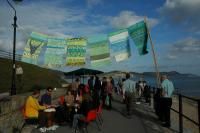 Photo of community event by the sea