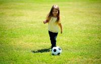 Girl playing football
