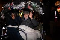 Photo of older person in carriage in parade