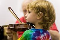 Photo of a boy playing the violin