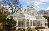An ornate white conservatory