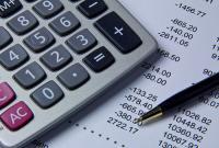 a calculator, pen and paperwork