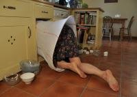 Image of woman entering kitchen cupboard