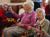 A Photo of elderly people taking part in a music workshop