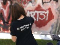 Photo of girl painting graffiti