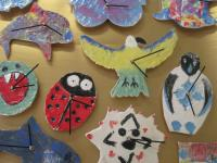 Picture of colourful clocks made on the Times Ticking Away workshop