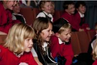 Photo of young children at a theatre performance