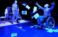 A photo of a performance including an actor in a wheelchair