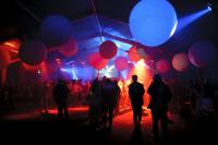 Photo of balloons in dark room