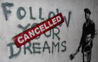 "The slogan ""follow your dreams"" overwritten with ""cancelled"""